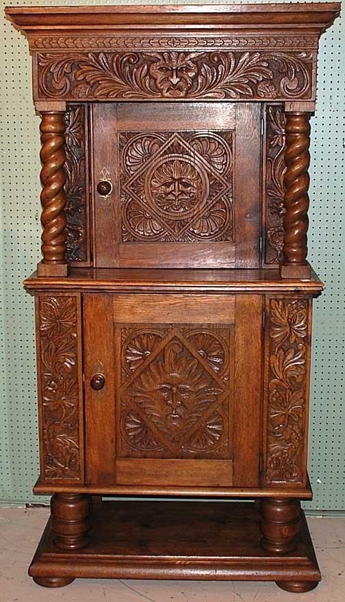 1016: Oak 19th century carved court cupboard, 1891 carv