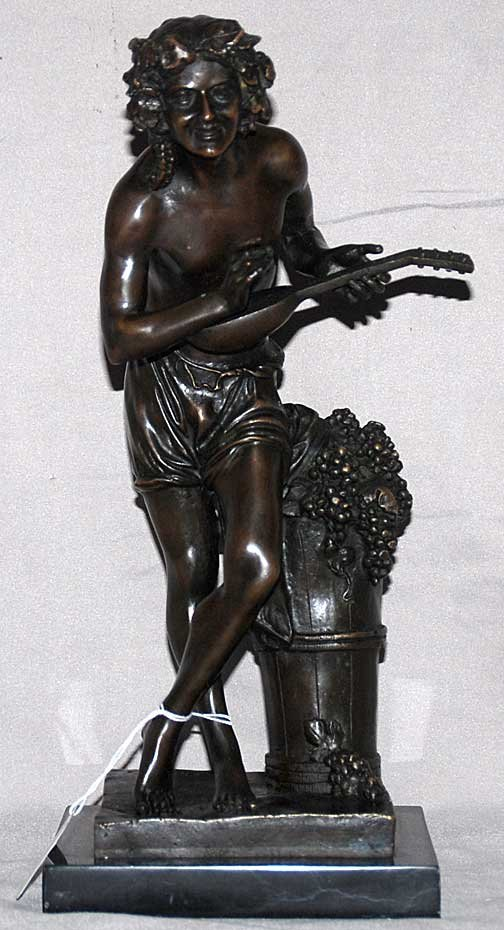 23: Bronze sculpture of man with grapes playing mandoli