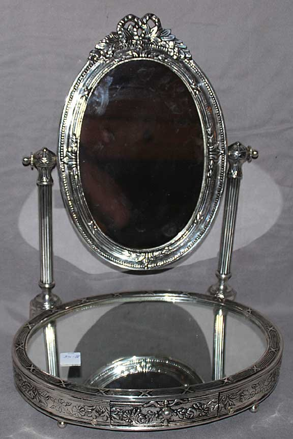 24: Silver plated mirrored plateau with jewelry drawer,