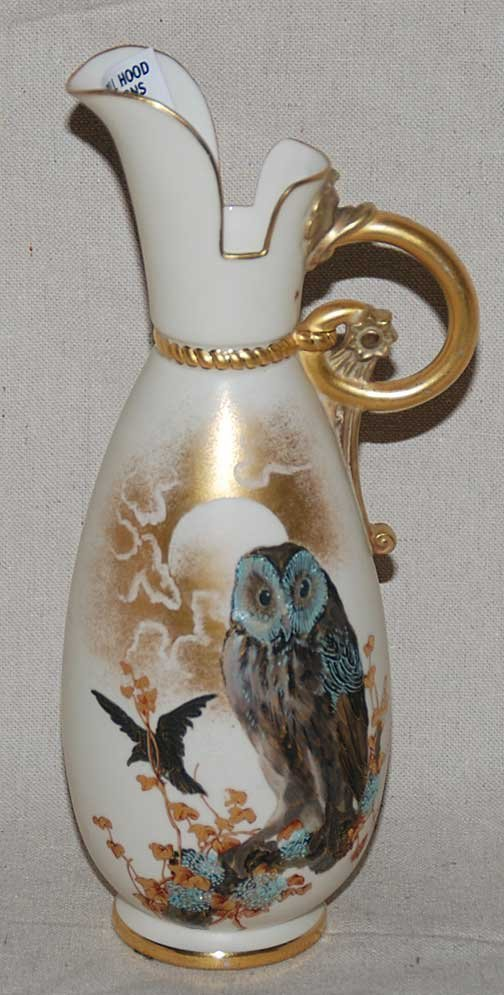 1009: Early 1900's porcelain ewer / pitcher, owl and bl