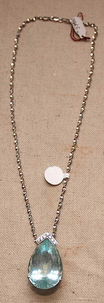 1144A: 48ct. Aquamarine pendent w/ 14kt. white chain, a