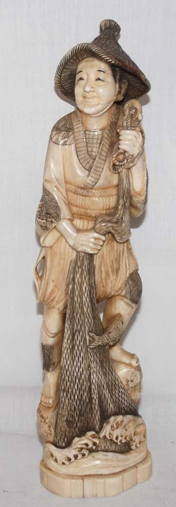 """4: Ivory fisherman with net, in original box, 11""""h"""