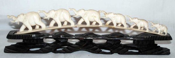"""12: 6"""" attached elephants on carved wood stand, at the"""