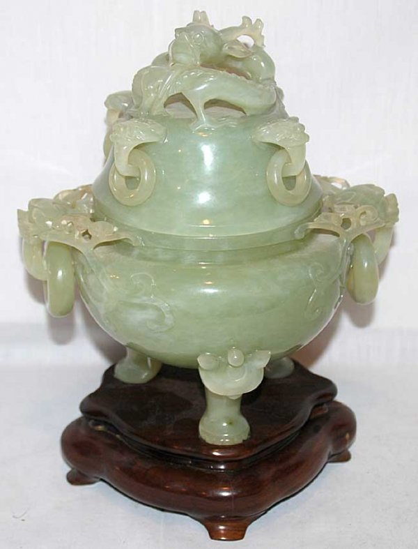 16: Foote and covered jade jar with multiple adornments
