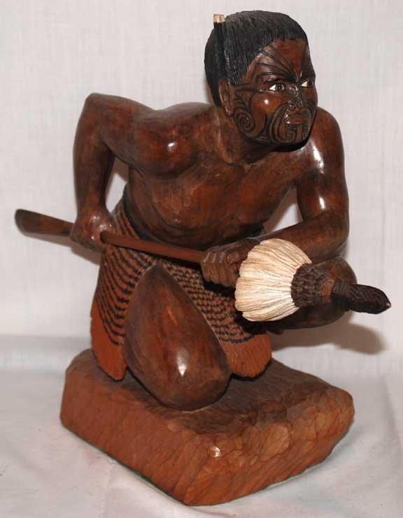 """24: Carved wood warrior, 14""""h x 15""""L"""