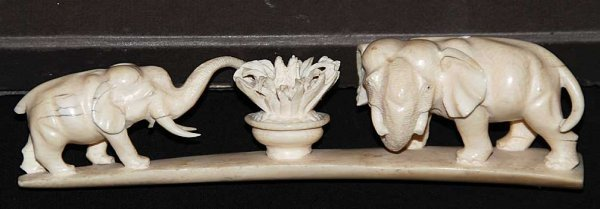"2: 2 ivory elephants carved on platform base, 7 1/4""L"