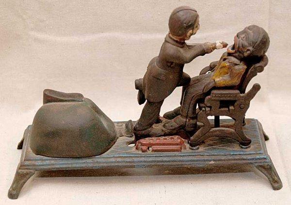 "35: Antique cast iron bank, ""Black man in Dentist Chair"