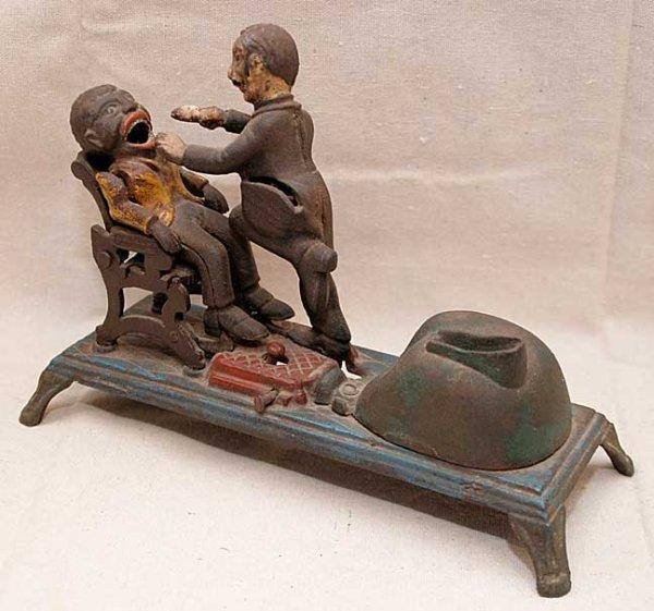 "35: Antique cast iron bank, ""Black man in Dentist Chair - 2"