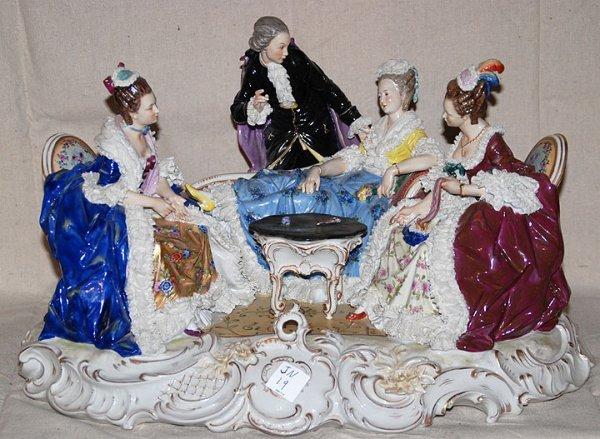 332: Elaborate unsigned porcelain figurine, 3 ladies an