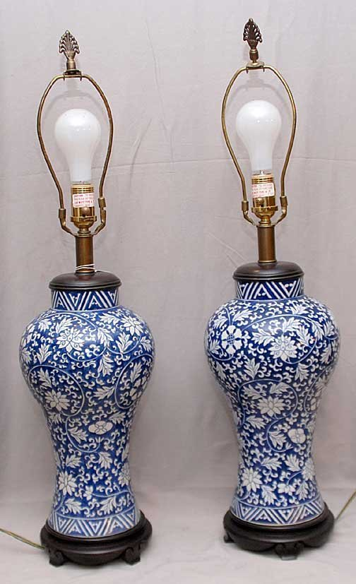 11: Pair of porcelain blue and white lamps on attached