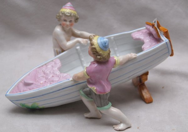 21: Unmarked European porcelain figurine of 2 lads and