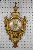 19TH CENTURY GILT BRONZE CARTEL CLOCK with time and