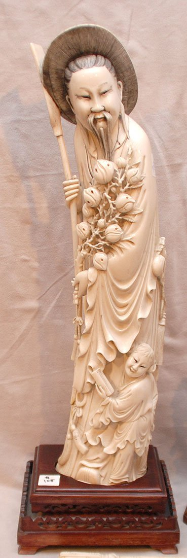 108: Large Carved ivory Tusk of gentlemen on wood stand