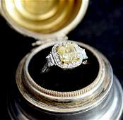 Ladies Platinum and 18K Fancy Yellow Gold Ring. GIA