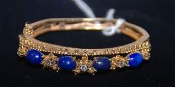 366: Bracelet, 14k yellow gold bangle style set with 4