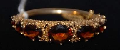 368: Bracelet, 14k yellow gold bangle style set with 7