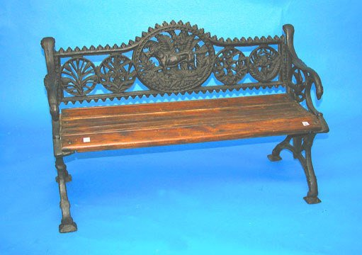 15: Iron and wood garden bench with dog in center medal