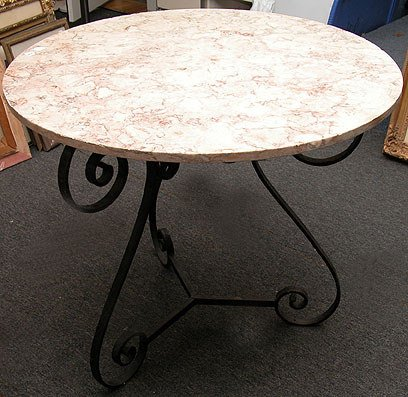 18: Iron scroll base table with round marble top