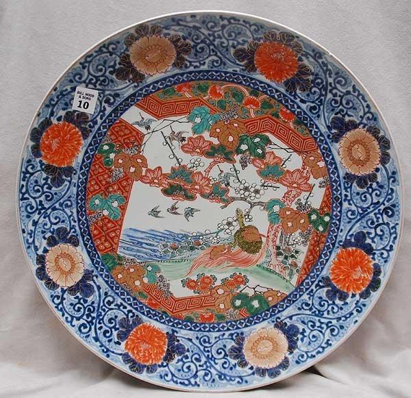 10: Oriental charger, blue, orange, green on white grou