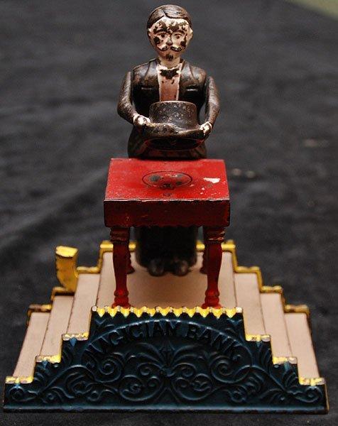 4: Magician cast iron mechanical bank, J. & E. Steven