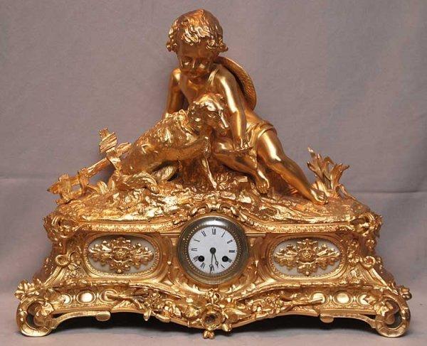 59: Dore Bronze mantle clock with child & dog