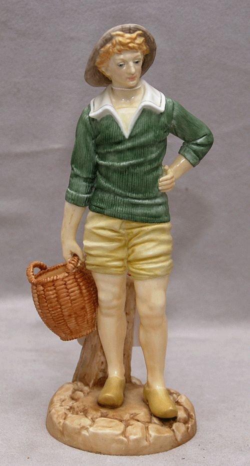 19: Royal Worcester figurine of lad holding basket, 7 1
