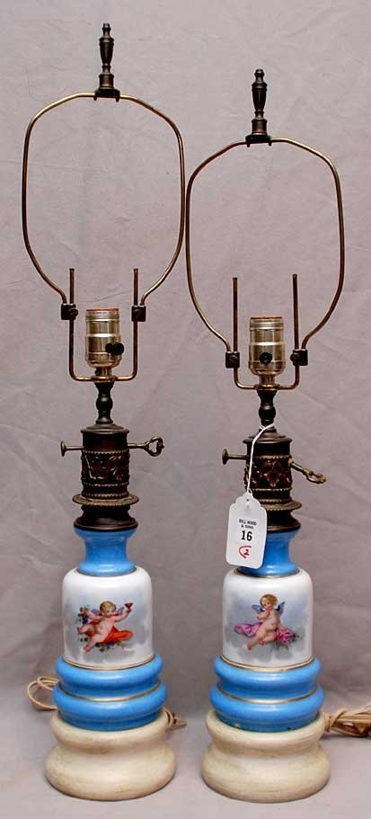 16: Pair of porcelain & brass lamps with painted putti