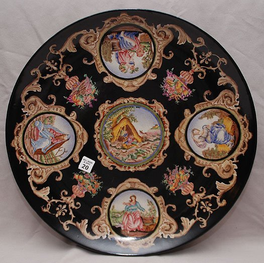 20: Large porcelain charger with painted scenes all ove