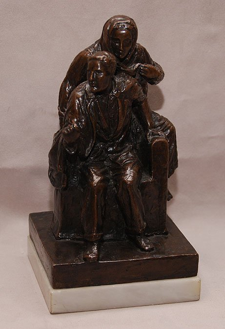 10: Bronze seated man with woman standing sign F. Titze