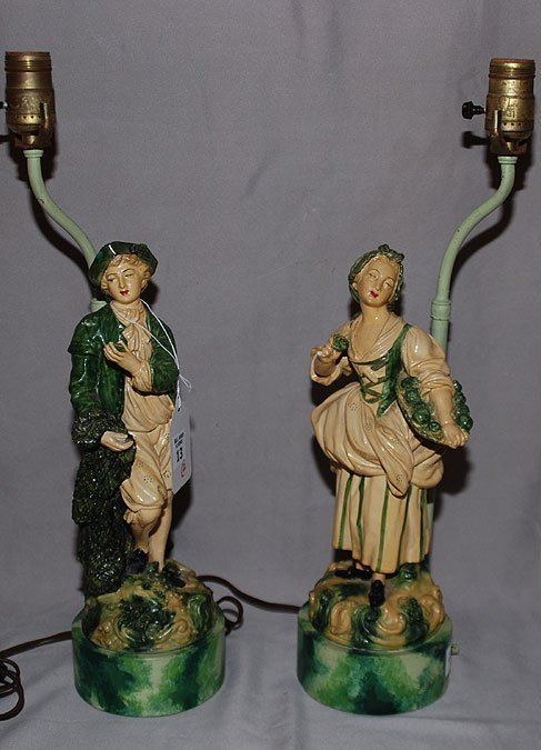 13: Pair of composition figural lamps on circular bases