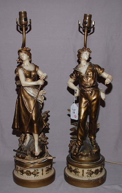 14: Pair ofcomposition figural lamps on circular decora