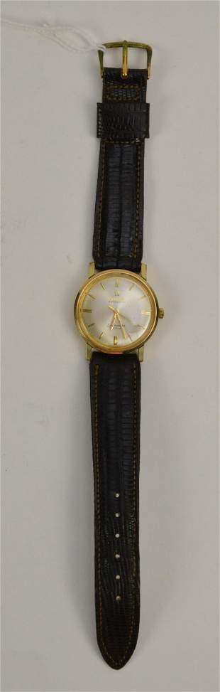 14K Yellow Gold Omega Seamaster with Leather Band.