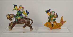 Two Chinese Porcelain Roof Tiles - One of a man astride