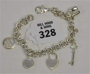 Sterling Silver Charm Bracelet with Charms. Weight 40.8