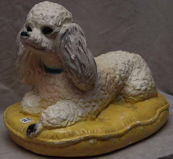 14: Full figured seated poodle on pillow, composition (