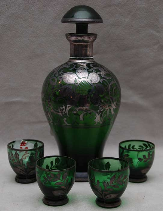 23: 5 piece cordial set, green glass with silver overla