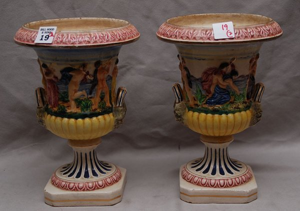 19: Pair of Italian china ware urns with figures in rel