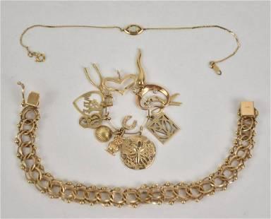 2 -14K Yellow Gold Bracelet & 11 Charms on Pendant. 1