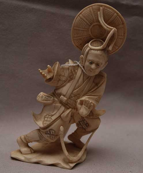 "20: Ivory figure in stance with snake, 5 3/8""H"
