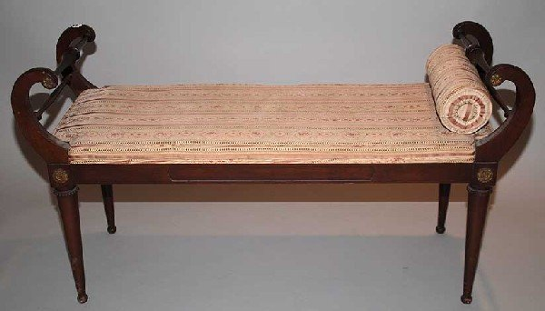 23: Mahogany bench with affixed cushion and curved ends