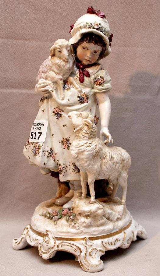 517: Continental porcelain figure, young girl with 2 la