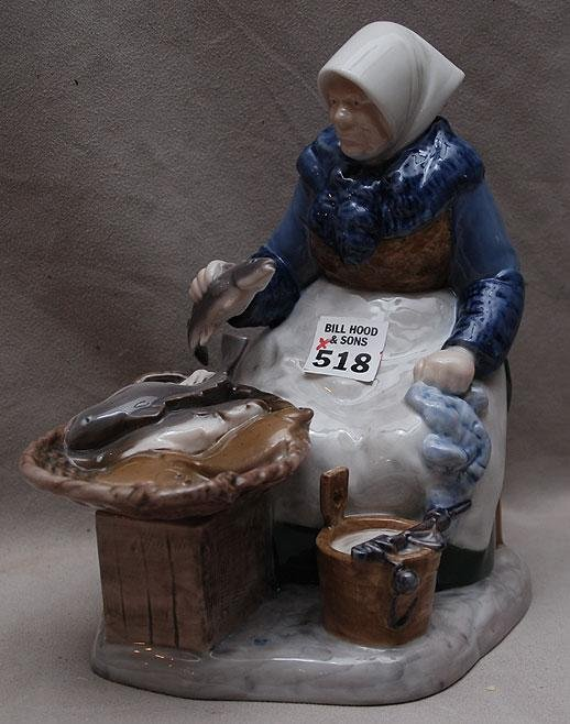 "518: B&G figurine of old woman with fish  ""2233HN"" 8""h"
