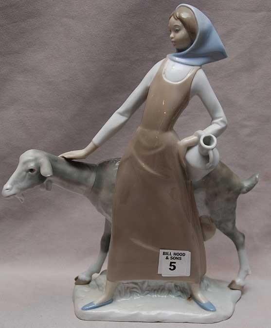 "5: Porcelain figurine ""Made In Spain"" maiden with goat,"