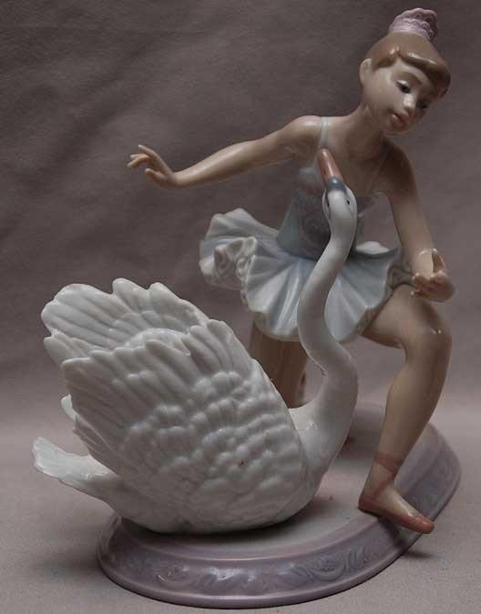 "6: Lladro kneeling ballerina with swan, 8""h x 8""w"
