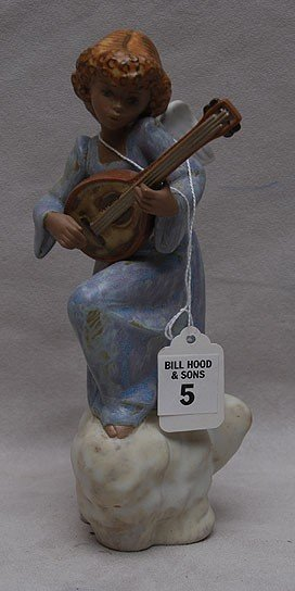 5: Lladro terracotta type pottery angel seated on cloud