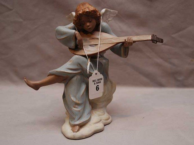 6: Lladro terracotta type pottery angel seated on cloud