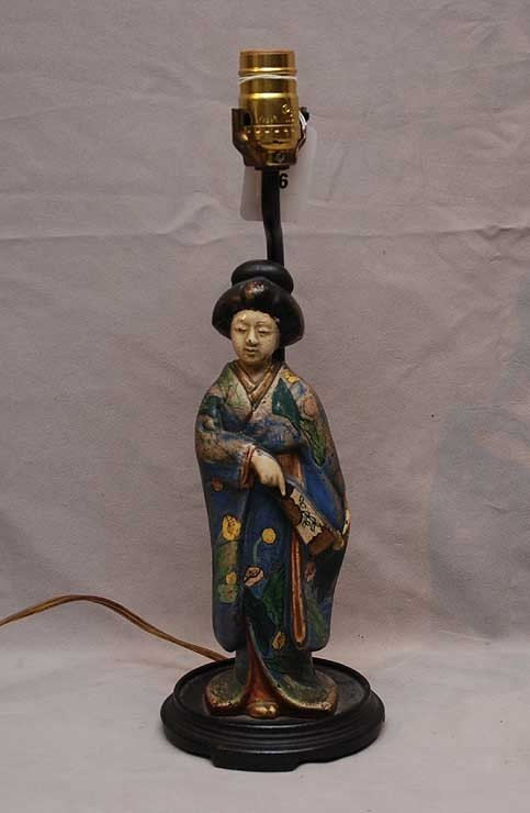 16: Oriental iron figural lamp of woman