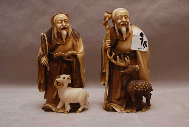 """7: 2 ivory wiseman, one is 5 1/8""""h and one is 5""""h"""