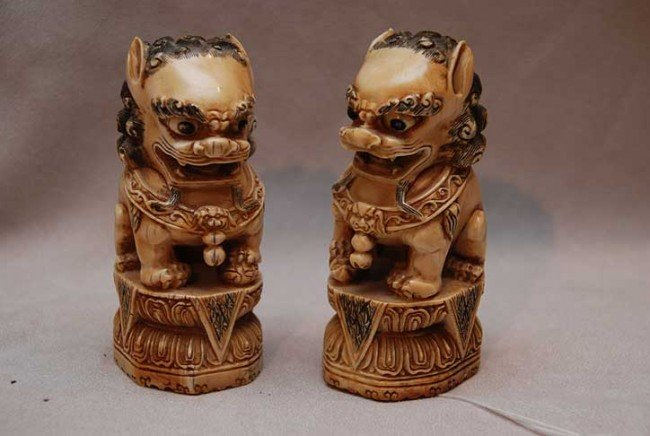 10A: Pair of Carved Ivory Foo Dogs.  Condition: very go