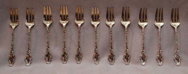 5: 8 sterling seafood forks, 5oz
